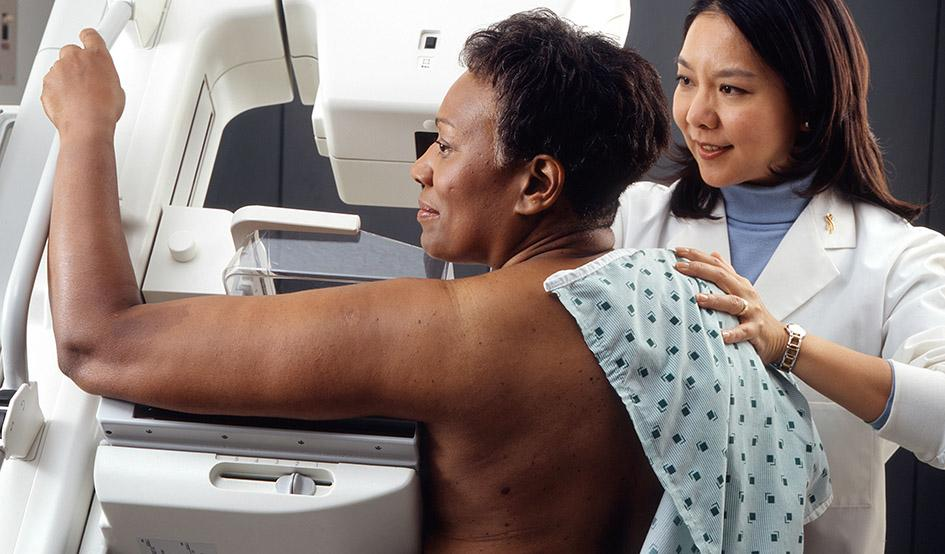 Larger woman receives mammogram