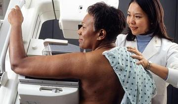 Small woman receives mammogram